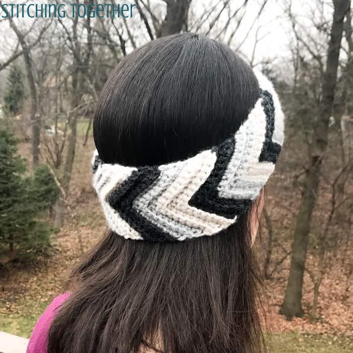 woman wearing striped crochet chevron ear warmer