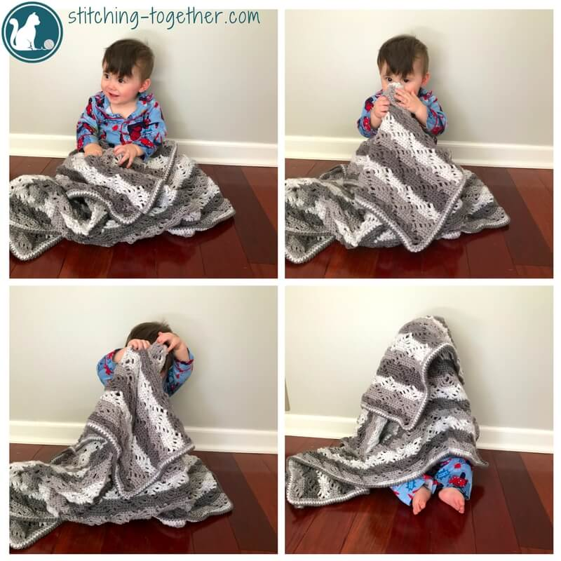 baby holding unisex crochet baby blanket - diamond lace baby blanket