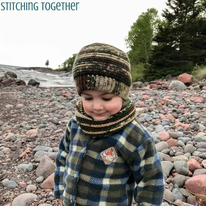 young boy wearing a crochet toddler hat in and matching scarf