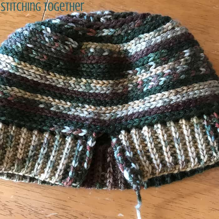 crochet hat with the band opened needing to be sewn together
