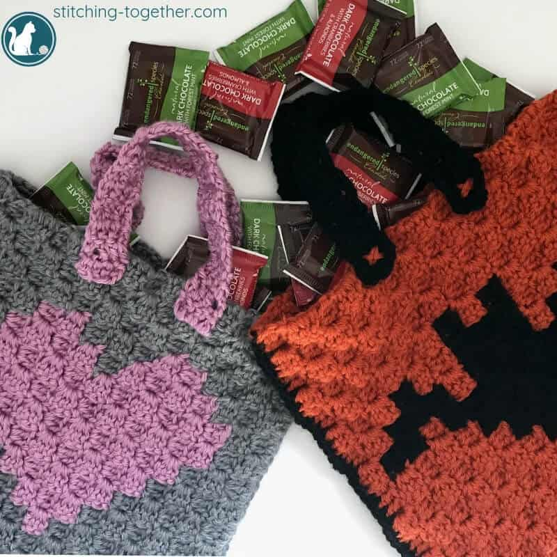 2 crochet trick or treat bags with chocolate