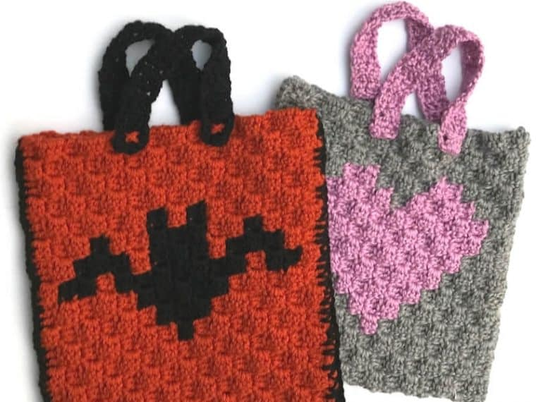 2 crochet trick or treat bags with bat and heart