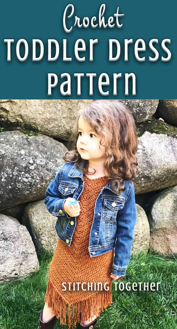 toddler in crochet dress and jean jacket