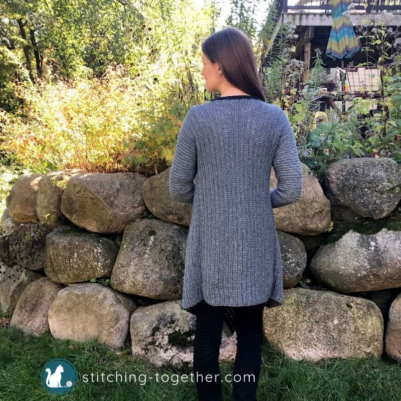 back of gray crochet blanket cardigan