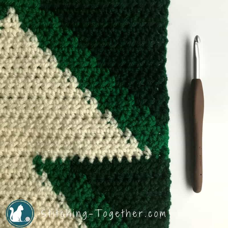 Cute Crochet Christmas Tree pillow cover. Get in the holiday spirit with this free crochet pattern. #RHSS #CrochetChristmas #Christmasdecor