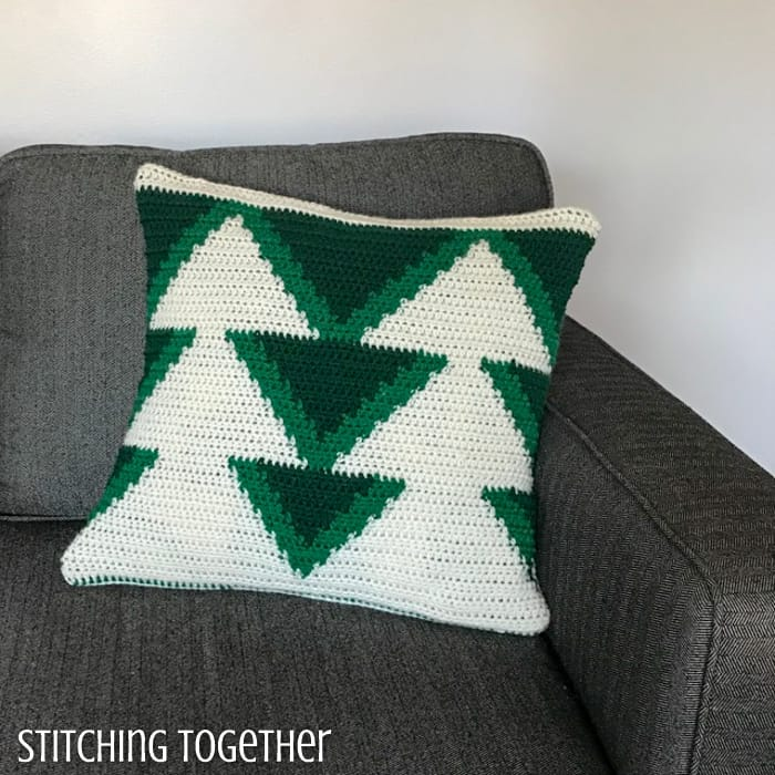 Crochet christmas tree pillow with white trees