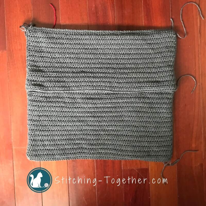 Back of gray crochet pillow cover