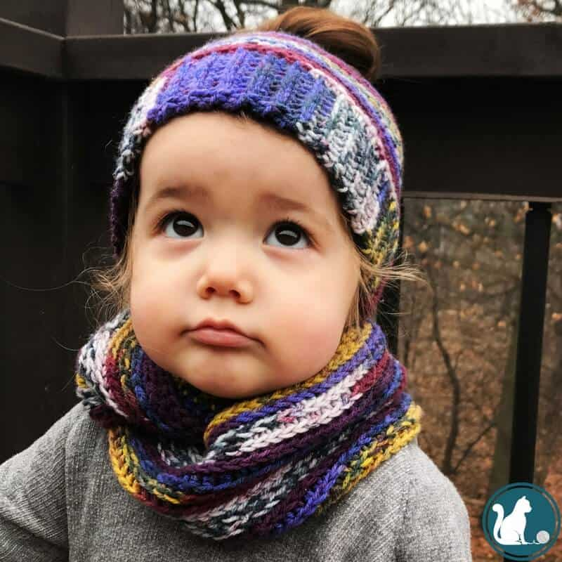 girl wearing crochet hat and scarf