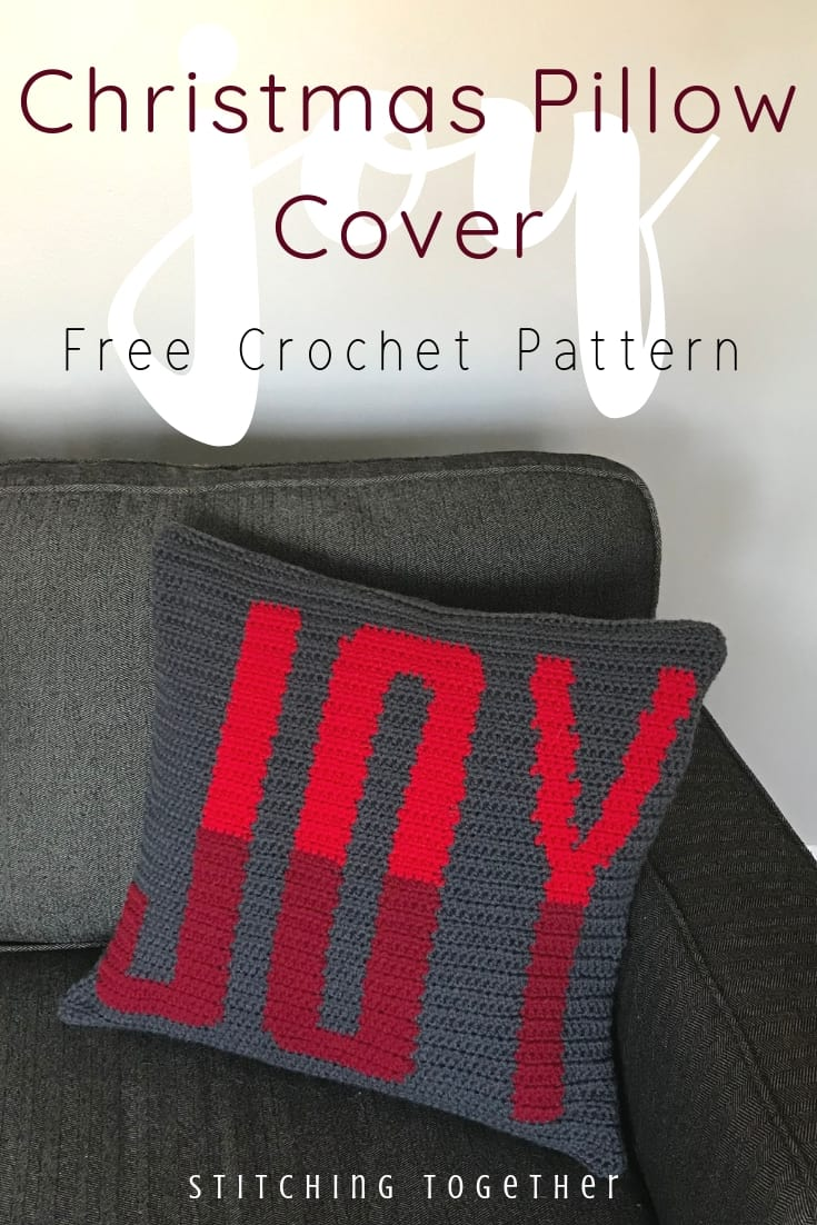 """Crochet Christmas Pillow with the word """"joy"""" and text overlay"""