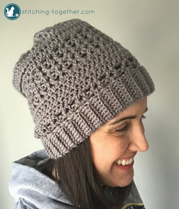 Lady wearing gray crochet slouchy hat with open stitches 5f50c65141d