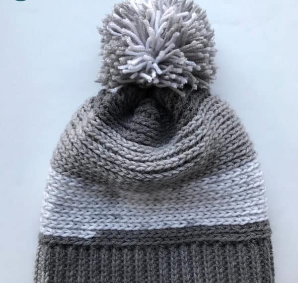 Check out this free pattern for a crochet slouchy hat perfect for kids! Super easy to make slouchy beanie extra fun in Premier Yarn Sweet Rolls. The pom pom adds the perfect touch!
