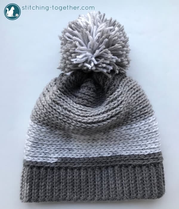 Chec out this free pattern for a crochet slouchy hat perfect for kids! Super easy to make slouchy beanie extra fun in Premier Yarn Sweet Rolls. The pom pom adds the perfect touch!