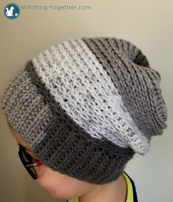 632b61242e3 Chec out this free pattern for a crochet slouchy hat perfect for kids!  Super easy