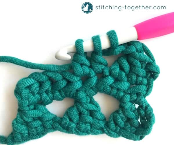 Learn how to crochet the Modified Cluster stitch with this full photo tutorial. The stitch creates adorable triangles which are great for scarves or accessories.