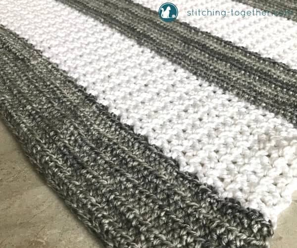 gray and white striped crochet v stitch blanket