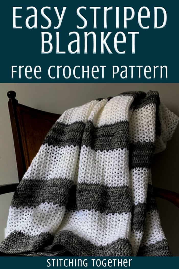 gray and white crochet throw blanket draped on a chair