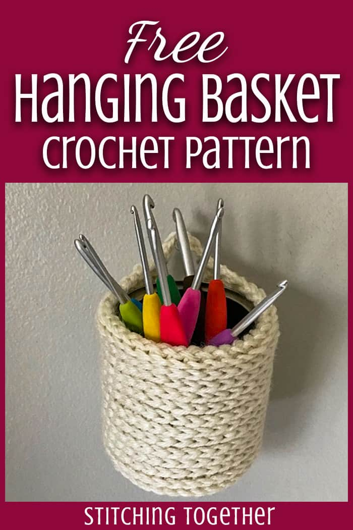 crochet basket hanging with crochet hooks inside
