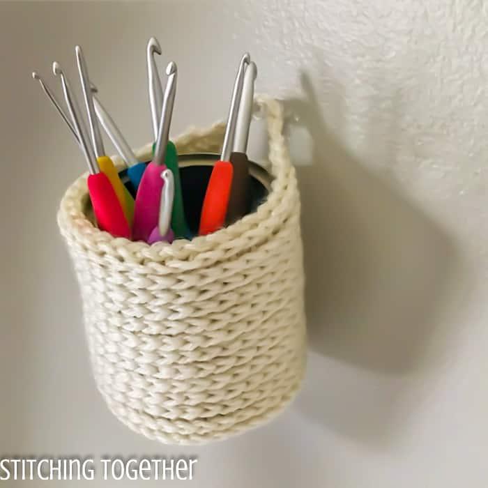 hanging crochet basket holding crochet hooks