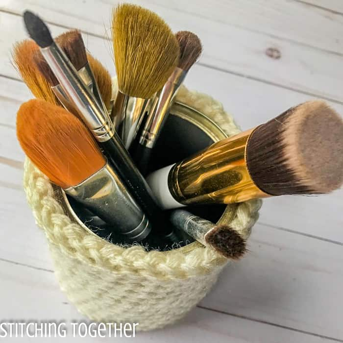 make up brushes inside a crochet basket