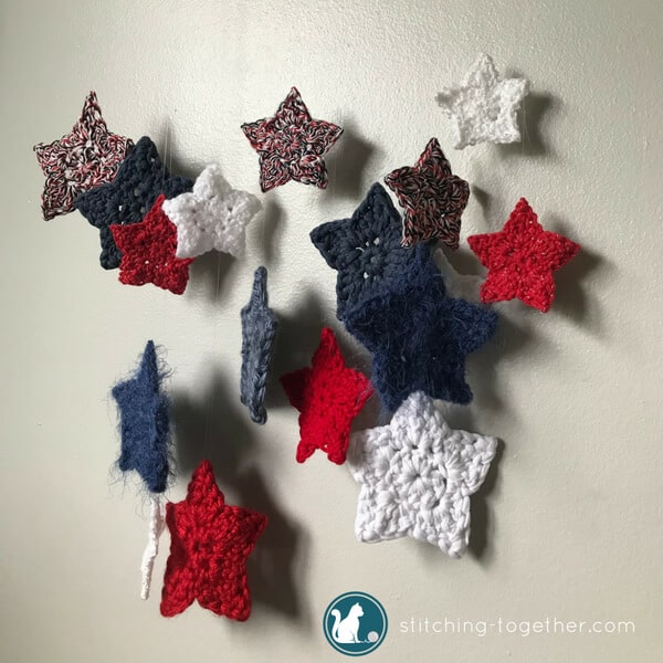 DIY this adorable crochet stars wall hanging! Using scrap yarn stars, invisible thread, and a tree branch, you can create this perfect holiday decoration. Make it red, white and blue for the 4th of July or red and green for Christmas. The possibilities ae endless with this fun and quick weekend project.