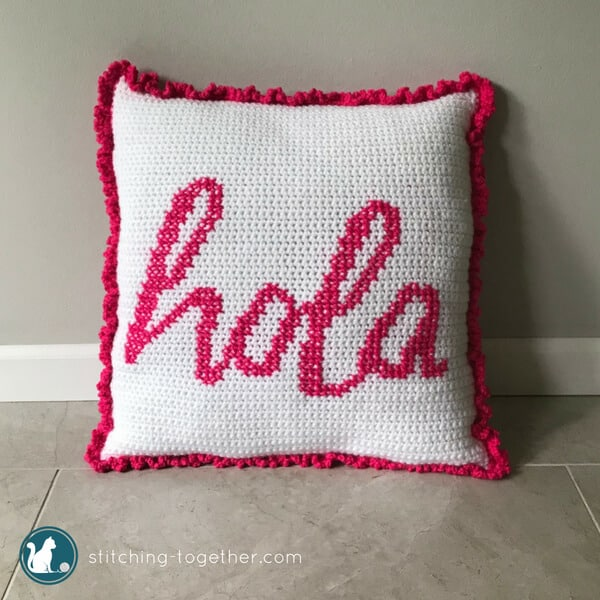 Get your house fiesta ready with this adorable hola crochet pillow pattern. This easy and free crochet pattern combines crochet and cross stitch to make a fun crochet cushion for your couch. Give your pillows a cover that will make them stand out in your living room!