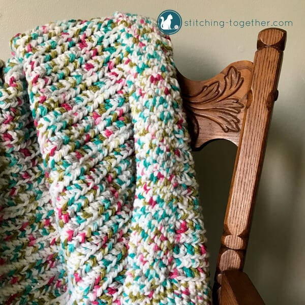 Close up of easy crochet baby blanket on chair