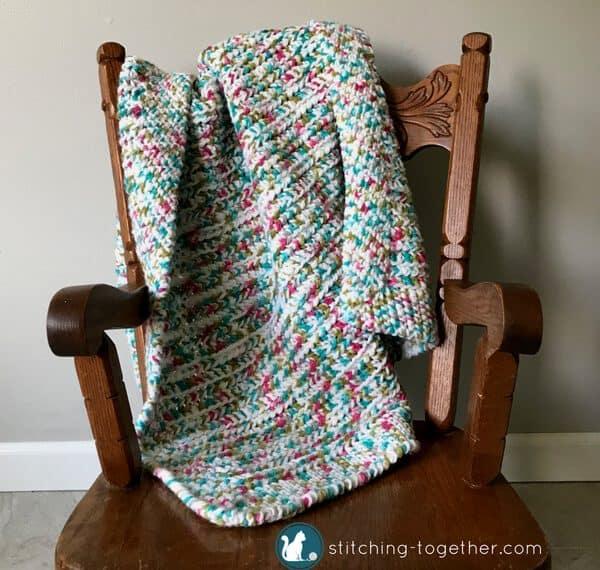 stroller blanket on chair
