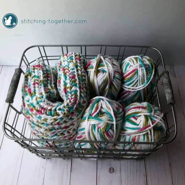 baby blanket and yarn in a basket