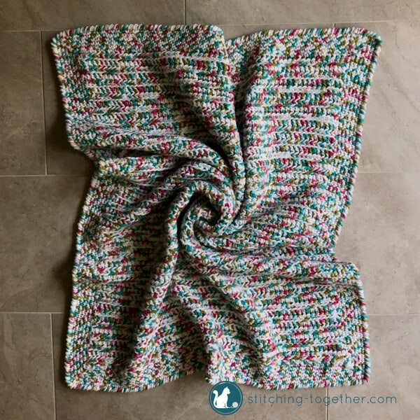 baby girl afghan on floor