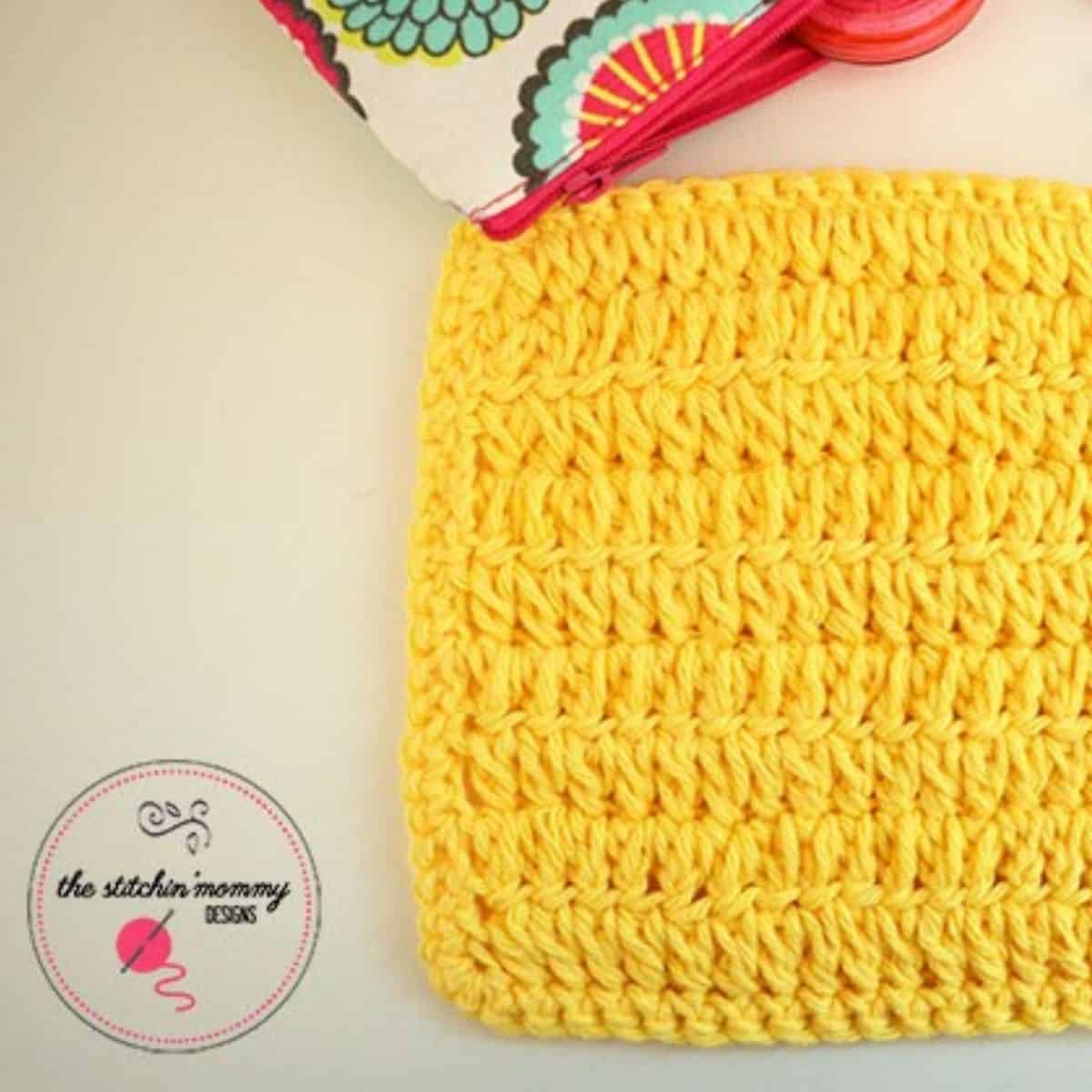 square swatch of yellow forked hdc stitches