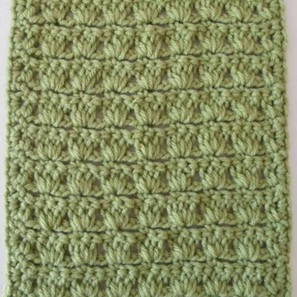 close up of a green swatch of textured crochet stitches