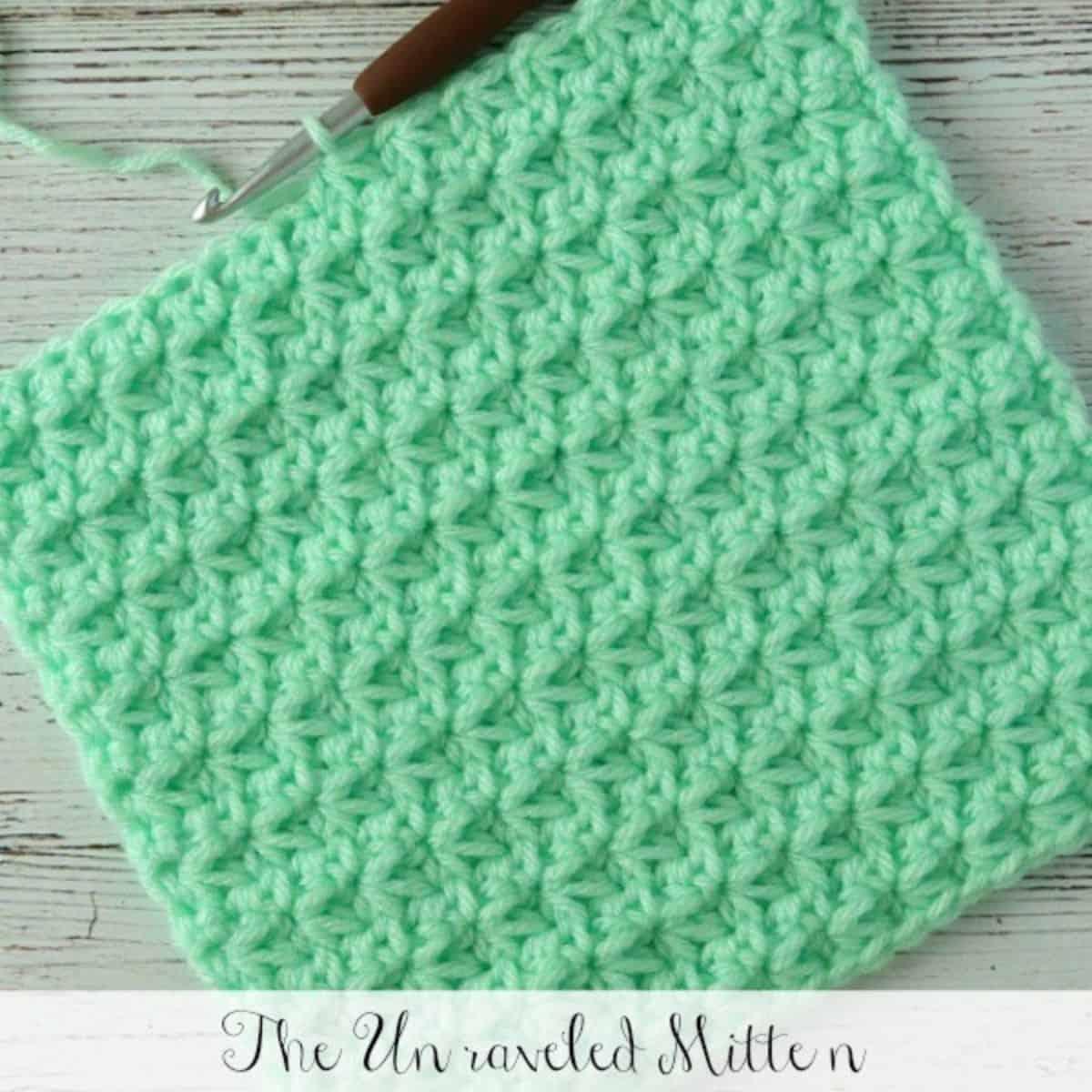 mint green trinity stitch dishcloth in progress