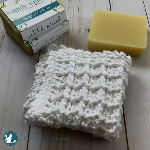 Waffle stitch washcloth next to soap
