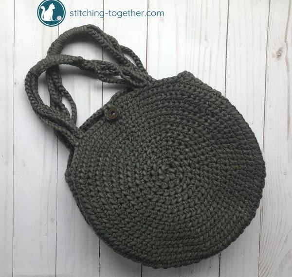 crochet circle bag laying on ground