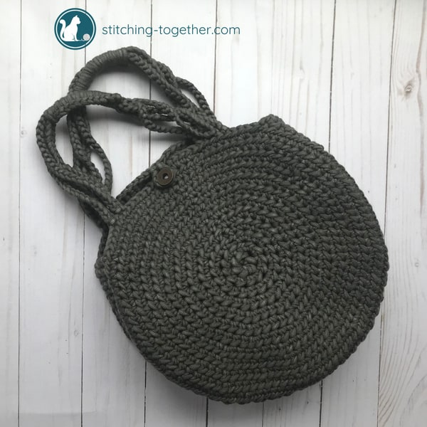 crochet circle bag laying on ground