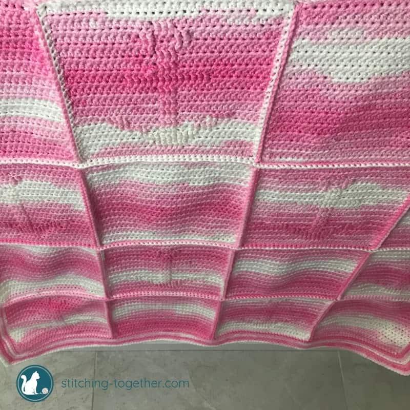 hanging pink crochet baby blanket