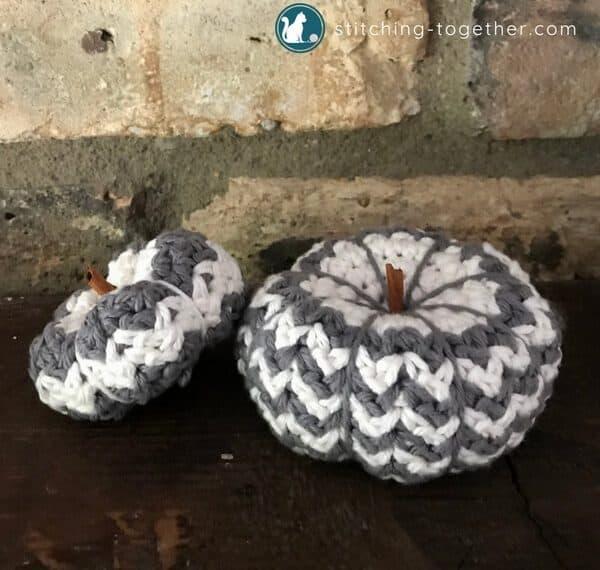 two crochet pumpkins
