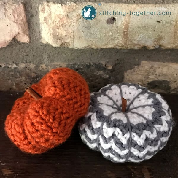 Orange crochet pumpkin and gray and white crochet pumpkin