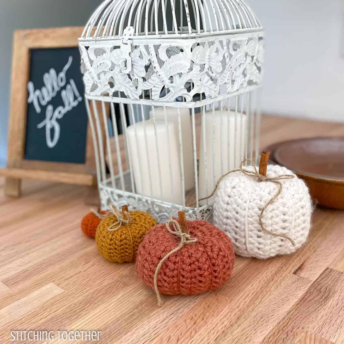 4 crochet pumpkins around fall themed decor