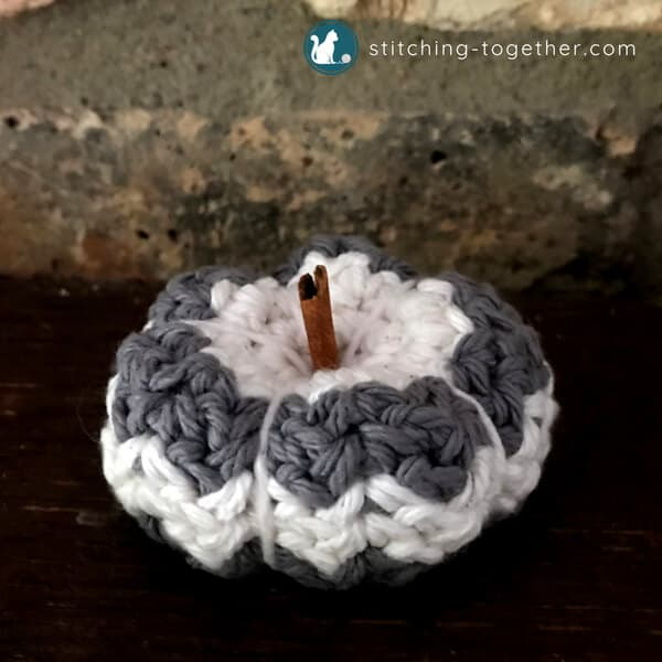 petite country crochet pumpkin with cinnamon stick