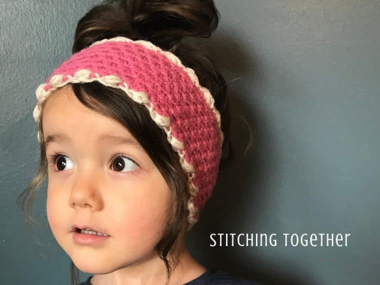 young girl wearing pink crochet ear warmer