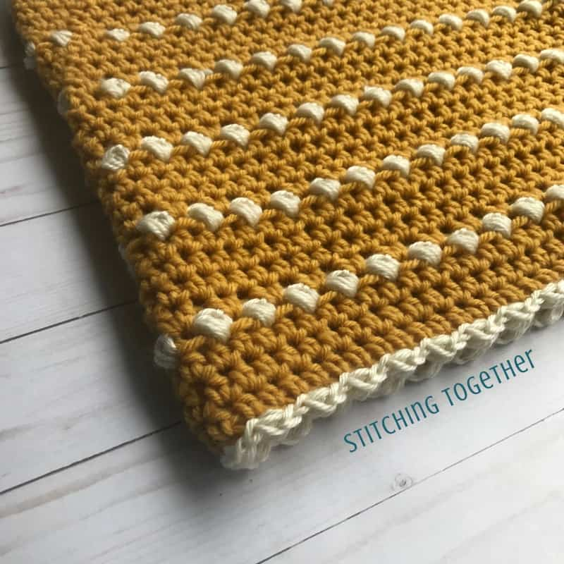 Mustard cowl crochet close up with puff stitches