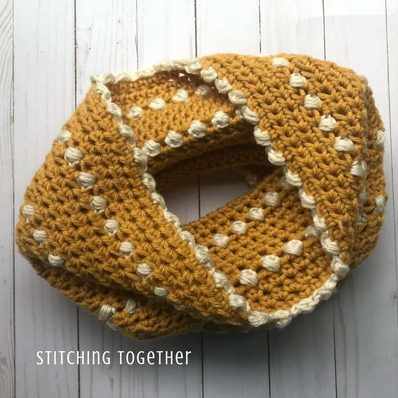gold crochet cowl with white puff stitches
