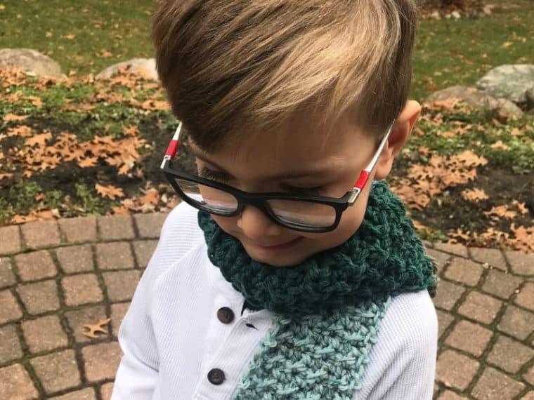 boy wearing a crochet scarf for a boy