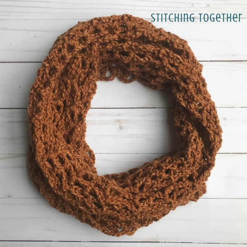 copper colored one skein crochet scarf in a circle