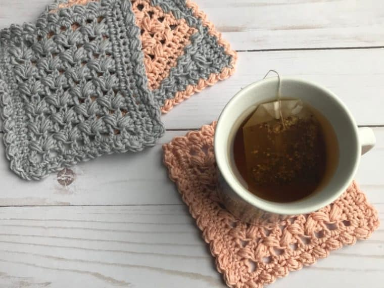 four crochet square coasters and a cup of tea