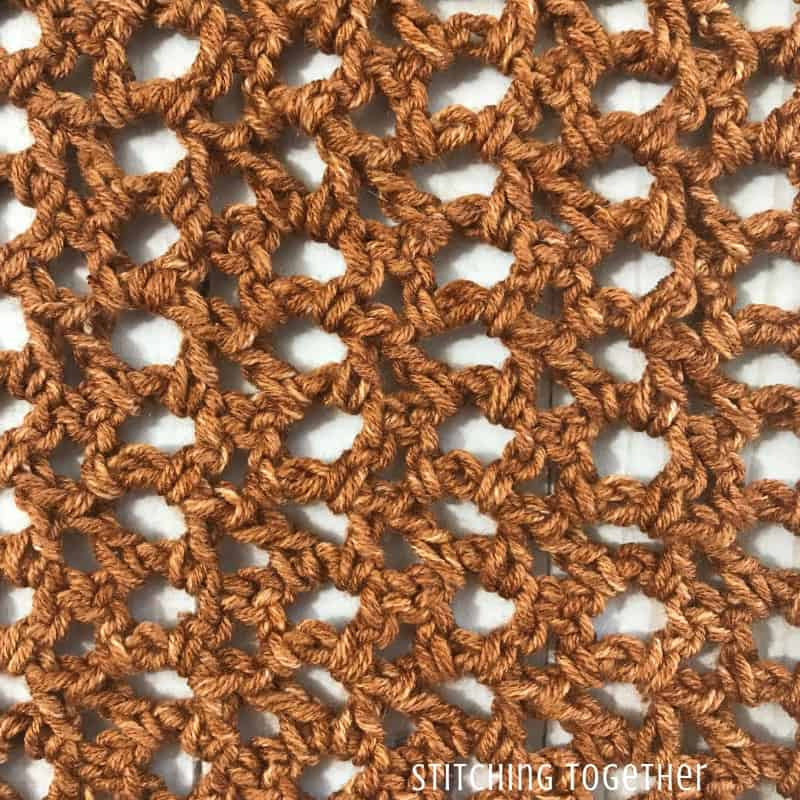 close up of copper colored crochet stitches