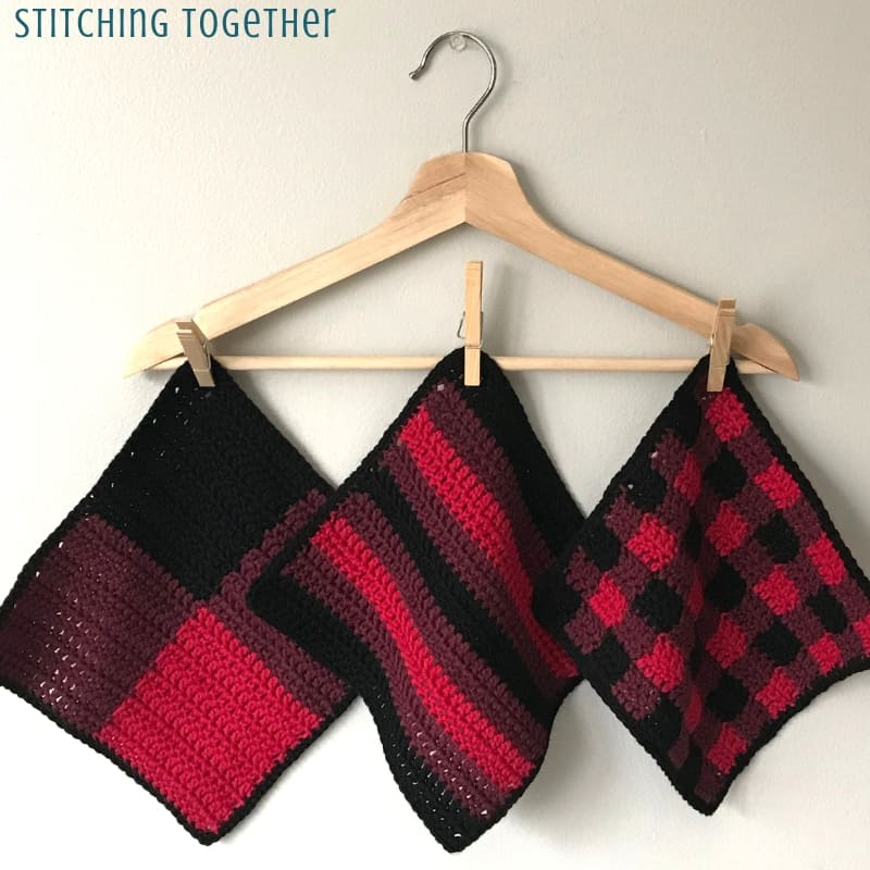 Buffalo plaid crochet dishcloth hanging on a hanger