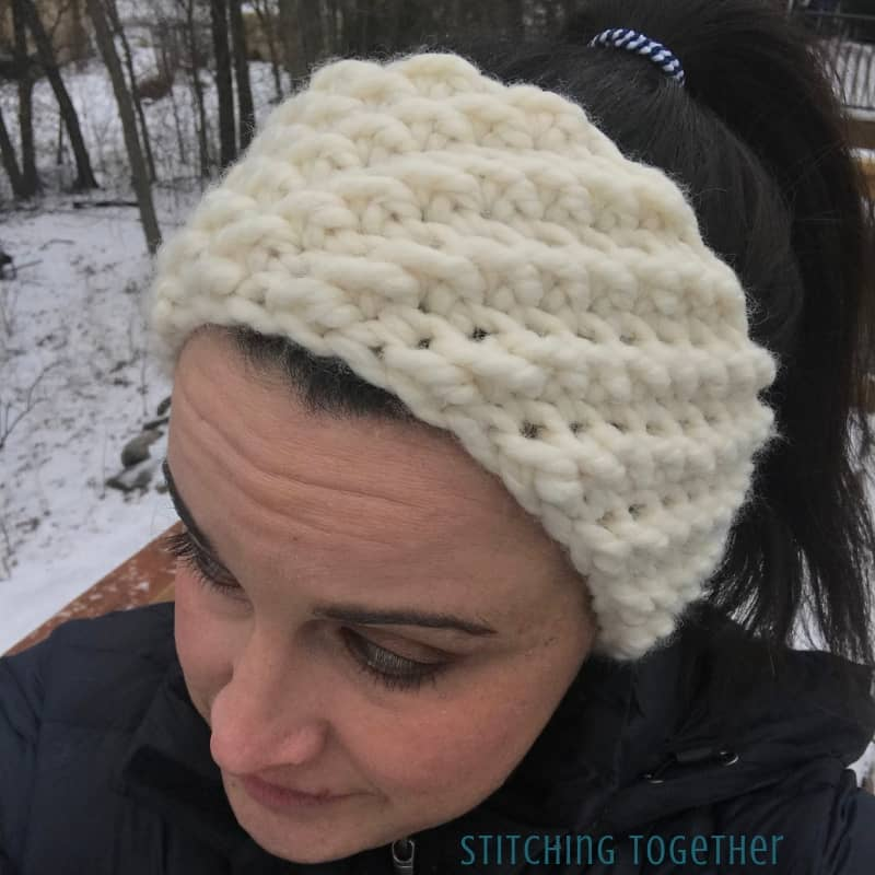 crochet winter headband being worn