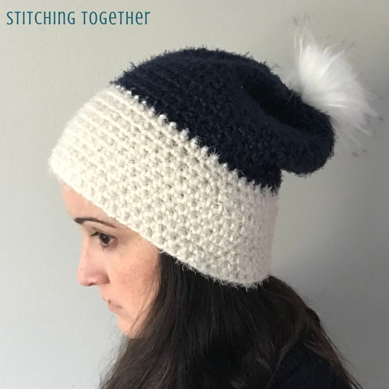side view of hdc slouchy hat in white and blue